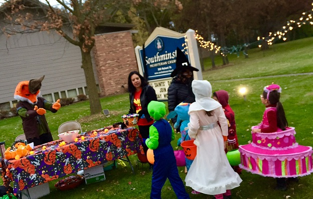 Stop by when you are trick-or-treating on Halloween, from 5-7 PM! We'll have treats and hot cider.